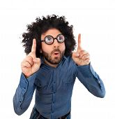picture of wig  - Funny man with the wig while pointing with the fingers an empty space - JPG