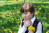 image of dandelion  - thoughtful little girl close - JPG