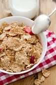 stock photo of cereal bowl  - cereals with dry fruits in white bowl and milk - JPG