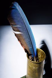 pic of inkpot  - Vintage inkpot with goose-quill inside retro writing instrument