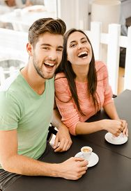image of youg  - Youg couple at the local coffee shop drinking a coffee - JPG