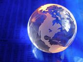 pic of stock market data  - glass globe on blue stock market and financial figures with orange highlights - JPG