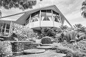 Постер, плакат: Modernistic Elvis Presley Honeymoon Home In Black And White