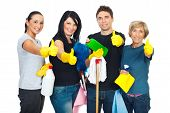image of house cleaning  - Successful cleaning people teamwork giving thumbs up and holding products for clean house - JPG