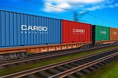 foto of railroad yard  - freight train with cargo containers with motion blur effect - JPG