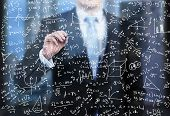 A Business Person Is Writing Down Math Formulas On The Glass Screen In The Evening Modern Panoramic poster