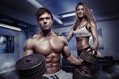 Beautiful Young Sporty Sexy Couple Workout In Gym poster