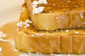pic of french toast  - french toast on a white plate with powdered sugar and maple syrup - JPG