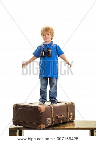 poster of Happy Child Boy With Binoculars Standing On Suitcase. Dream Of Travel. Traveling. Vacation, Travel,