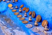 Colorful Moroccan Fabrics And Handmade Souvenirs On The Street In The Blue City Chefchaouen, Morocco poster