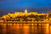 Buda Castle By The Danube River, Illuminated At Dusk In Budapest, Hungary. poster