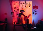 Halloween Witch With A Carved Pumpkin And Magic Lights In A Dark Forest. Halloween Background. Jack- poster