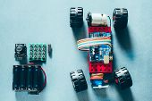 Electronic Project Construction. Handmade Rc Car Model With Remote Control. Copy Space. poster