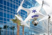 Police Unmanned Aircraft System, (UAS) Drone Flying Near City Highrise Building. poster