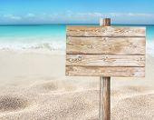Wooden Planks Sign Board On The Beach Blurred Background.  Tropical Island Paradise. Sandy Shore Was poster