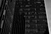 Black Glass Silhouette Of Skyscraper At Night.the Gloomy City Of Skyscrapers. Black And White. poster