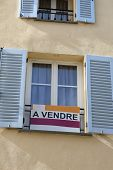 Apartment For Sale Sign (a Vendre In The French Language) In Front Of An Apartment Building In Caste poster