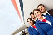 picture of cabin crew  - Airplane cabin crew at the airport smiling - JPG