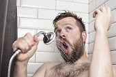 Cute Bearded Man Singing In The Bathroom Using The Shower Head With Flowing Water Instead Of A Micro poster