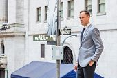 Young Businessman Street Fashion In New York City. Young Man Wearing Gray Blazer, White Undershirt,  poster