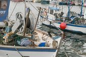 View Of The Fishing Boats In The Port. Mooring Of The Small Fishing Vessel At The Dock. Fishing Gear poster