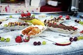Banana With Candy And Chocolate On Street Food Festival. Spechial Food Sold On Open Kitchen Food Fes poster
