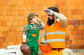 Hard Work. Working Day. A Team Of Builders Are Tired At Work. A Man And A Boy In A Suit Of Builders. poster