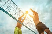 Beach Volleyball players in sunglasses in action with ball under sunlight. Popular Dynamic outdoor s poster