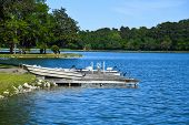 Fishing Boats At The Boat Dock On A Recreational Fishing Lake poster