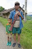 Laotian Hmong With Rifle And Children