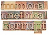 immoral, unethical, corrupt - ethics concept - a collage of isolated words in vintage letterpress wo