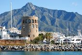 picture of sea-scape  - Harbour entrance with the watchtower to the left and La Concha mountain to the rear Puerto Banus Marbella Costa del Sol Malaga Province Andalucia Spain Western Europe - JPG