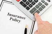 stock photo of insurance-policy  - Document of Insurance Policy and calculator for background - JPG