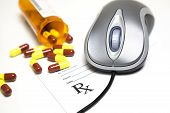 picture of prescription pad  - Computer mouse and pills placed on a prescription pad - JPG