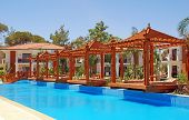 picture of pergola  - Summer landscape with resort swimming pool and wood pergola - JPG