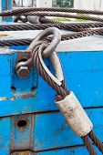 picture of shackles  - Close up heavy duty bolt anchor shackle and wire rope sling on crane counter weight - JPG