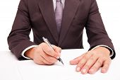 Business worker signing the contract on white