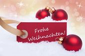foto of weihnachten  - A Red Banner with the German Words Frohe Weihnachten Which Means Merry Christmas on It - JPG