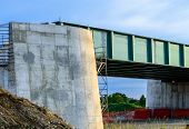stock photo of trestle bridge  - closeup bridge road under reconstruction on blue sky - JPG
