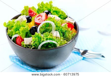 Salad. Greek Salad isolated on a White Background. Mediterranean Salad with Feta Cheese, Tomatoes an poster