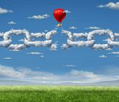 image of breakup  - New Markets Breakthrough business concept as a group of clouds shaped as a linked chain being broken throgh by a businessman in a hot air balloon as a success metaphor for freedom from the shackles of repression and dirty air - JPG