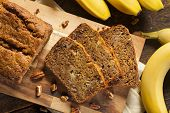 stock photo of carbohydrate  - Homemade Banana Nut Bread Cut into Slices - JPG