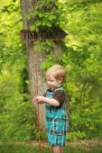 foto of little boy  - Close focus on a toddler holding a bamboo fishing pole with a  - JPG