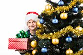 Happy Child With Gift Near The Christmas Tree