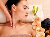 picture of low-necked  - Masseur doing massage the neck of an adult woman in the spa salon