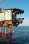 image of oil drilling rig  - Lifting new unit into place on a fixed platform in the North Sea - JPG