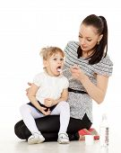 picture of babysitter  - Young mother feeds her baby on a white background - JPG