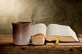 foto of holy-bible  - still life with Bible chalice and bread