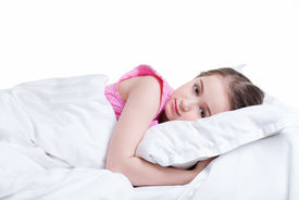 picture of nighties  - Adorable little girl in pink nightie awake in the bed on a white background - JPG