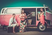 stock photo of guitar  - Young hippie friends with guitar on a road trip - JPG